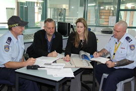 Corrective Services staff around a table
