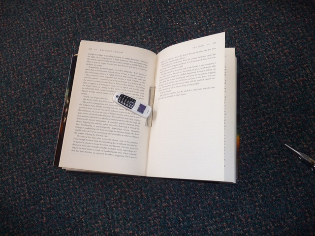 Photo of the 3cm mobile phone and the book it was hidden in