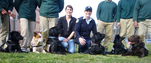Dog trainer Teneka Priestly and Corrective Services Officer Chantelle Raso with dogs.